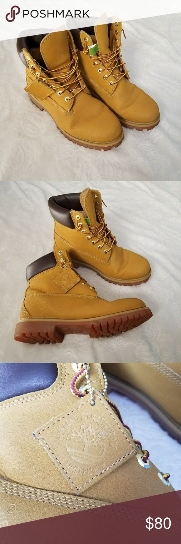 """Timberland Original Hightop Waterproof Boots These boots from Timberland are guaranteed waterproof, 100% leather. 2 small flaws to note, price written on bottom of boots, and slight cracking on one boot ( shown in last photo). Overall great condition.  Size 8 mens. Man made upper lining,  man made outsole. Boots in color """"wheat"""" smooth, not suede feel, hightop style. Timberland Shoes Boots"""