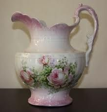 Not a fan of pink, but am a fan of floral porcelain.  I am inches away from being a chintz person, I'm not kidding.  [vintage water pitcher]
