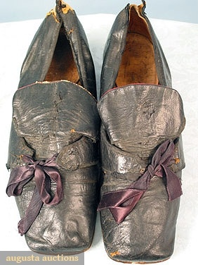 "PAIR GENTLEMAN'S SHOES, MID 18TH C  Black leather, square toes, red leather under tongue and on heels, shoes are from ""Lederman Collection"" purchased early 20th C & exhibited in Europe & USA, 3"" x 10.5""."