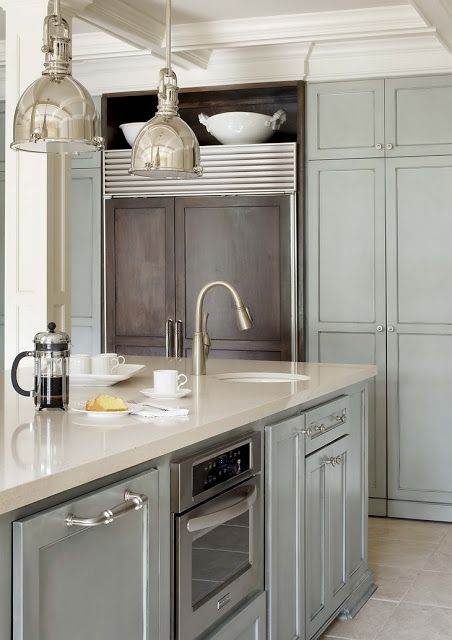 Blue gray cabinets - pretty with the cream colour counter.