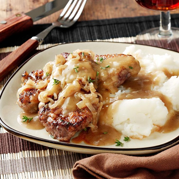So-Tender Swiss Steak Recipe -This fork-tender Swiss steak with rich gravy was an often-requested main dish around our house when I was growing up. Mom took pride in preparing scrumptious, hearty meals like this for our family and guests. -Linda McGinty, Parma, Ohio