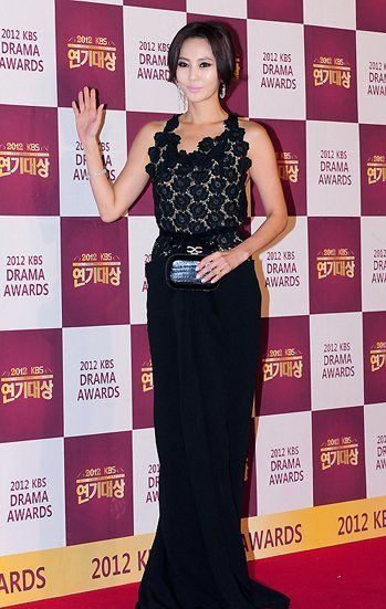 South Korean actress Kim Nam Joo 김남주 attended the 2012 KBS Drama Awards in Seoul, South Korea on December 31, 2012. Kim Nam is wearing a black Roland Mouret 'Hexam' draped lace and crepe gown. Her stunning dress features a delicate lace bodice rapped around a romantic drapery thigh high slit skirt.