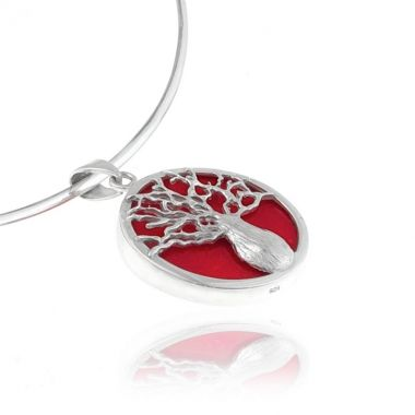 A 925 silver round shaped pendant featuring a vibrant red coral gemstone set in a modern silver Tree of Life design. Symbol of life and wisdom in ancient Greek mythology, this inspiring red coral silver pendant, is sure to make an eye-catching impression. Add extra colour and vitality to your daily casual and business outfits. Create versatile looks, by matching it with delicate red coral sterling silver earrings or chunky red coral sterling silver bracelets.
