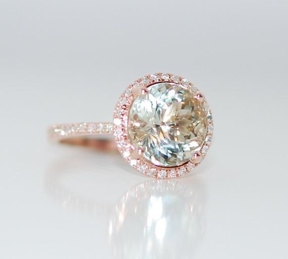 It a natural non-treated beauty, approx. 3.15ct, mint green with blue overtone. Clean and sparkling!  The setting is 14k rose gold, TDW