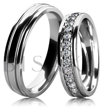 DB6-5 Elegantní snubní prsteny z bílého zlata, které jsou celé v lesklém provedení (vysoký lesk). Vzhledem k jemnému a elegantnímu provedení dámského prstenu, lze tento model snadno kombinovat se zásnubním prstenem. Dámský prsten je do poloviny zdoben kameny. #bisaku #wedding #rings #engagement #svatba #snubni #prsteny #design