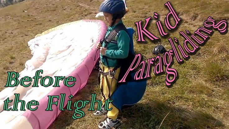 Kid getting ready for Tandem Paragliding in Nepal, Sarangkot/Sarankot. Adventure Sports