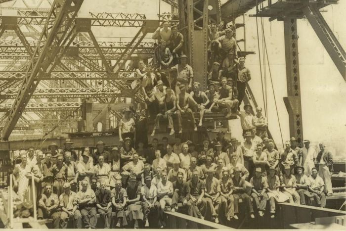 Brisbane's heritage-listed Story Bridge is 75. On the last day of construction circa 1939, crew assembled for this group photo. (Photo: Supplied/John Oxley Library/State Library of Queensland)