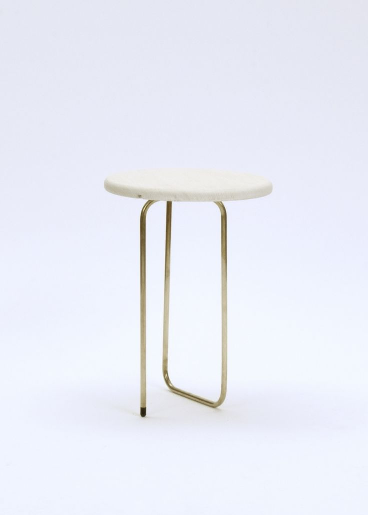 Small table with marble top and sleek/modern brass/gold base