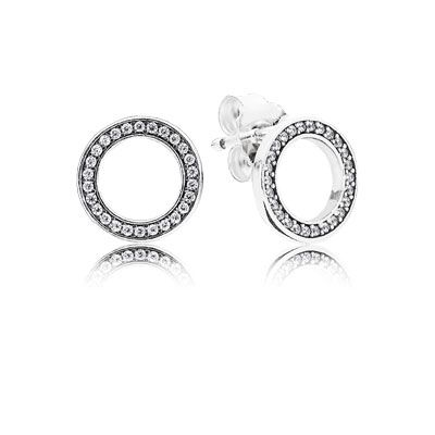These simple, circular earring studs are embellished with sparkling accents that add subtle shine to the graphic design. Perfect for everyday wear. #PANDORA #PANDORAearrings