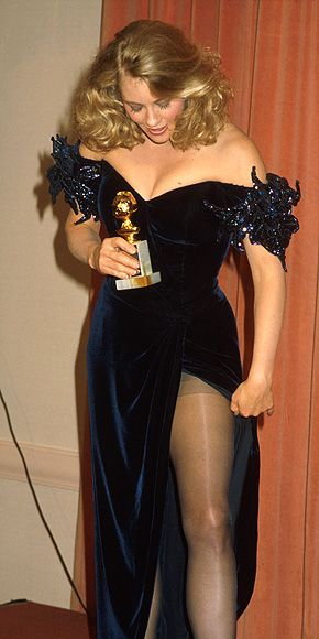 Cybill Shepherd, star of 'Moonlighting' shows a little leg while posing with her first-ever Golden Globe in 1986. Shepard also won the Best Actress award the following year for the series.