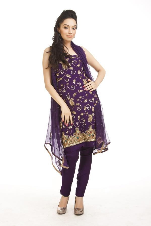 Imperial purple georgette suit with spaced floral jaal embellished with swarovski, bugle beads, crystals and zardozi. Borders at hemline with bold and heavy embellishment of thread, zardozi and crystals. This comes with duppata and unstitched salwar.