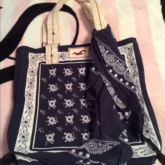 Hollister tote bag Super cute Hco tote bag, pretty white and navy floral print on front and back, I added the matching scarf for something extra & it is removable. Used only a couple times. Inside pockets are shown, magazine to show size. Straps do have some discoloration from use, but hardly noticeable. Hollister Accessories