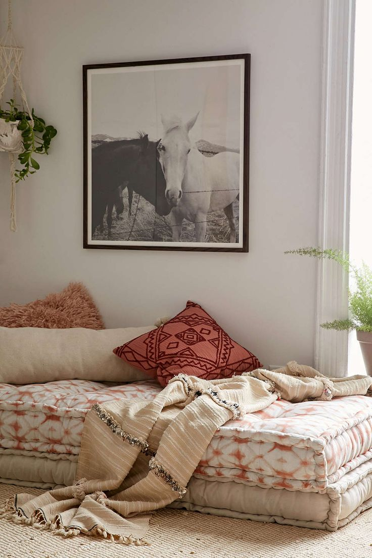 25 Bohemian Bedroom Decor Ideas That Will Make You Want to Redecorate ASAP | Chic daybed with boho textiles | @stylecaster