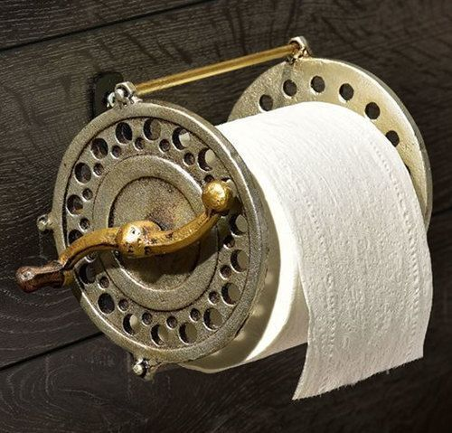 The Iron Fly Fishing Reel Toilet Paper Holder makes a rustic addition to a lakehouse bathroom.