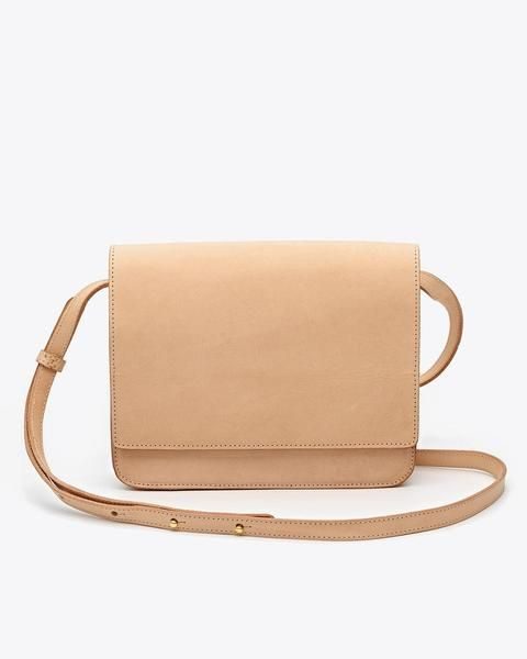 Elegant, simple, and understated, you'll want to carry the Clara Crossbody purseall around town. With its structured, clean lines and natural vachetta leather, Clara issure to make you stand out in the best way possible. Natural vachetta leather is vegetable tanned leather with a natural or unfinished surface that develops a patina over time. Just like how the lines on our faces are a result of years of love and laughter, natural vachetta leather will only become more beautiful and uniq...