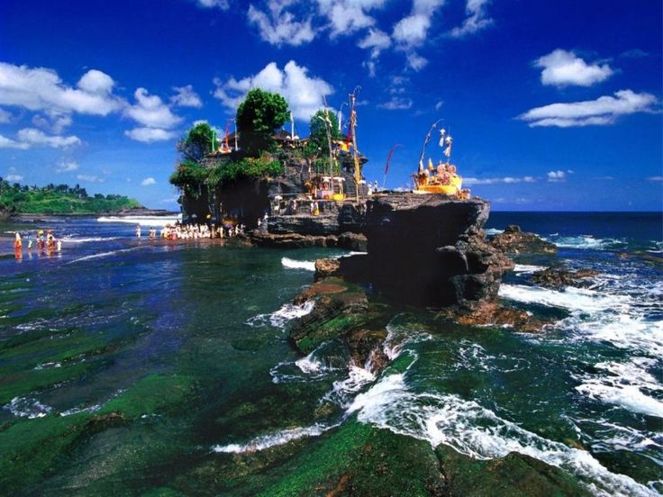 Tanah Lot Sunset tour is one of Bali tours package which just simply escorts you directly to one of the most beautiful & famous temple on a small rock in the sea, Tanah Lot Temple. The temple is l - - YukmariGO.com