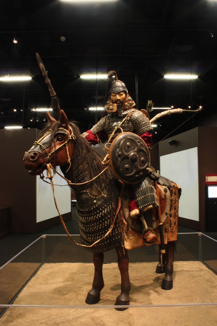 Mongol heavy cavalryman, the horse has half armour, rider armed with lance and bow and has a shield.