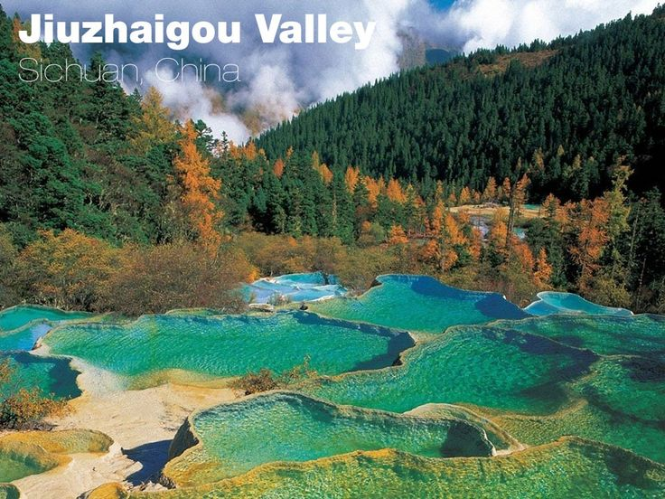 The Jiuzhaigou Valley natural reserve and national park is located at the edge of the Tibetan plateau. Thanks to its location, it boasts a number of waterfalls and vast forests fringed with the snowcapped peaks of he Min mountains beyond. In autumn, the leaves turn various hues of red, which, along with the waterfalls, gives the place its distinctive, surreal color.