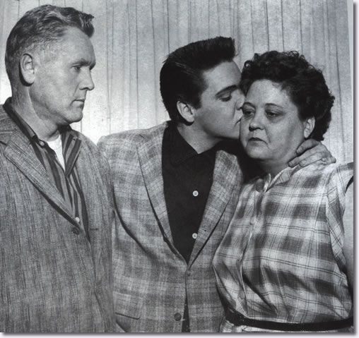 Elvis, kisses his mother goodbye before reporting to the Memphis Draft Board, where he and twelve other recruits are inducted into the US Army.