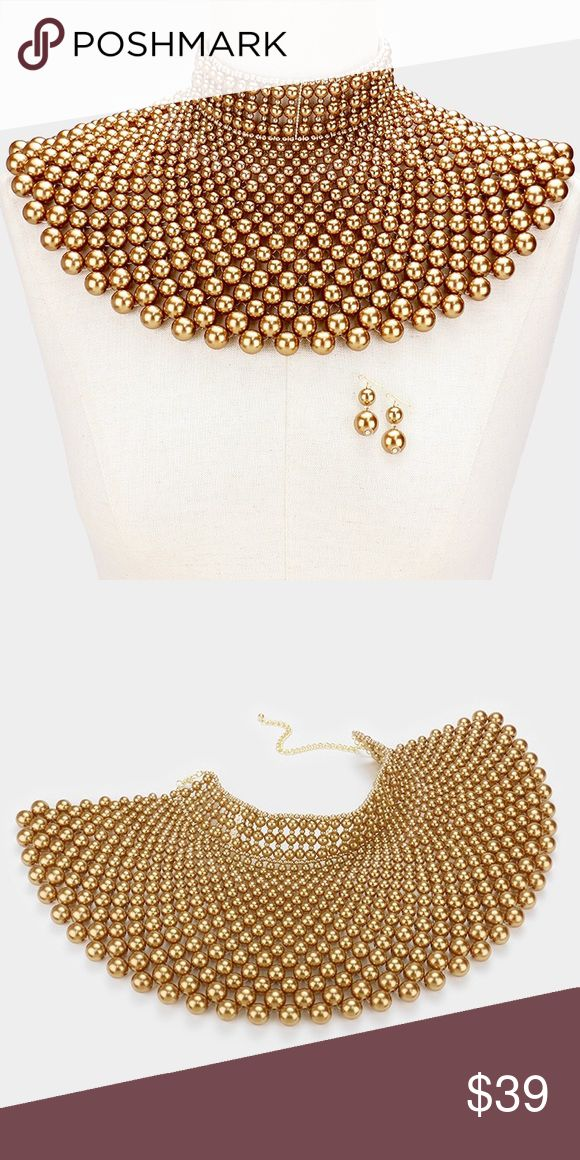"""Cleopatra Statement Pearl Bib Necklace Set Beautiful Statement Cleopatra Themed Bib Necklace Set. Great worn for weddings, Mother's Day, Easter or any special occasion.   Color : Gold Theme : Pearl  Necklace Size : 13"""" + 4"""" L Decor Size : 6"""" L Earrings Size : 1.75"""" L Jewelry Necklaces"""