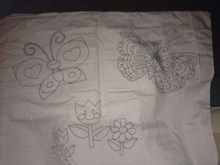 Place a sheet of carbon paper under any color sheet and trace onto fabric. Outline with sharpie and let the kids color in with dry erase markers. This is a pillowcase. Can be done on any fabric. Won't wash out. Enjoy!