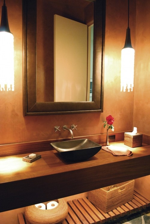 This is a very classy vanity with the two draping pendents which create a beautiful, soothing illumination effect in this spa-esque bathroom.   Caption by Jenn Brown