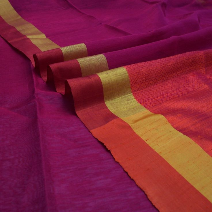 #Handwoven Magenta Pink Silk Cotton Sari with Orange Jacquard Pallu ~ How the pallu becomes the highlight of a sari! In this instance, with its two bands: one of raw silk and the other of jacquard weaves. A perfect way to make a simple silk cotton sari into something special. The mustard yellow and orange bands on the border enhance the magenta pink sari. Vibrant is the word and gorgeous is the effect! Sari code: 750512344