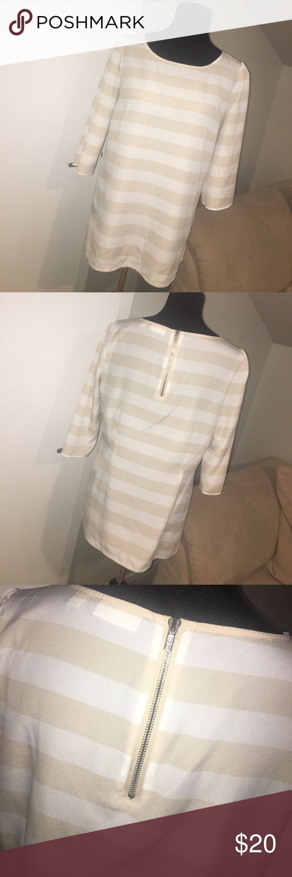 Cream & white striped blouse with zipper detail Cream & white striped blouse with zipper detail. Slightly puckered shoulders for very feminine touch! New York & Company Tops Blouses