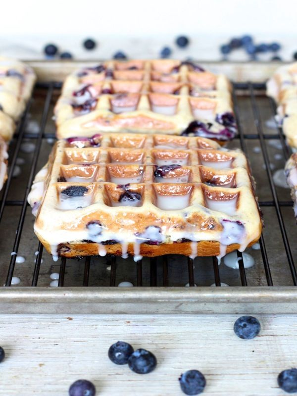 Blueberry Cake Waffles - crispy waffles that are bursting with juicy blueberries and coated in a sweet sugar glaze just like a good ol' blueberry cake donut!