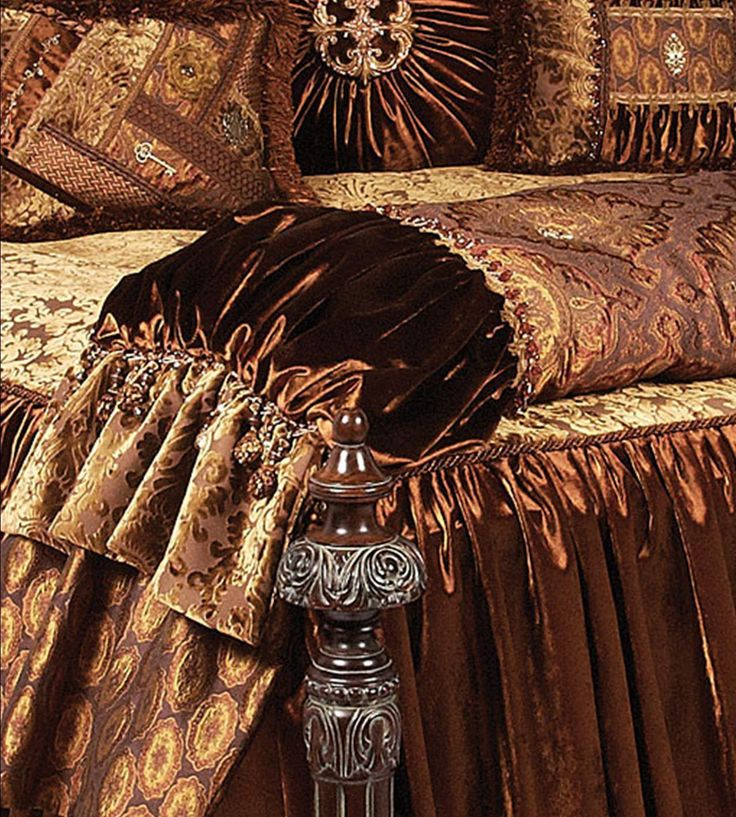 Brussels Luxury Bedding Collection designed in gold toned cut velvet damask mixed with beautiful bronze velvet and a coordinating print that almost glimmers. The pillows combine faux mink with beads, brush fringe, braids and the most beautiful Swarovski crystal medallions! Our over sized bedding is designed to fit the larger beds of today with ample drop on both the duvet and the dust skirt.