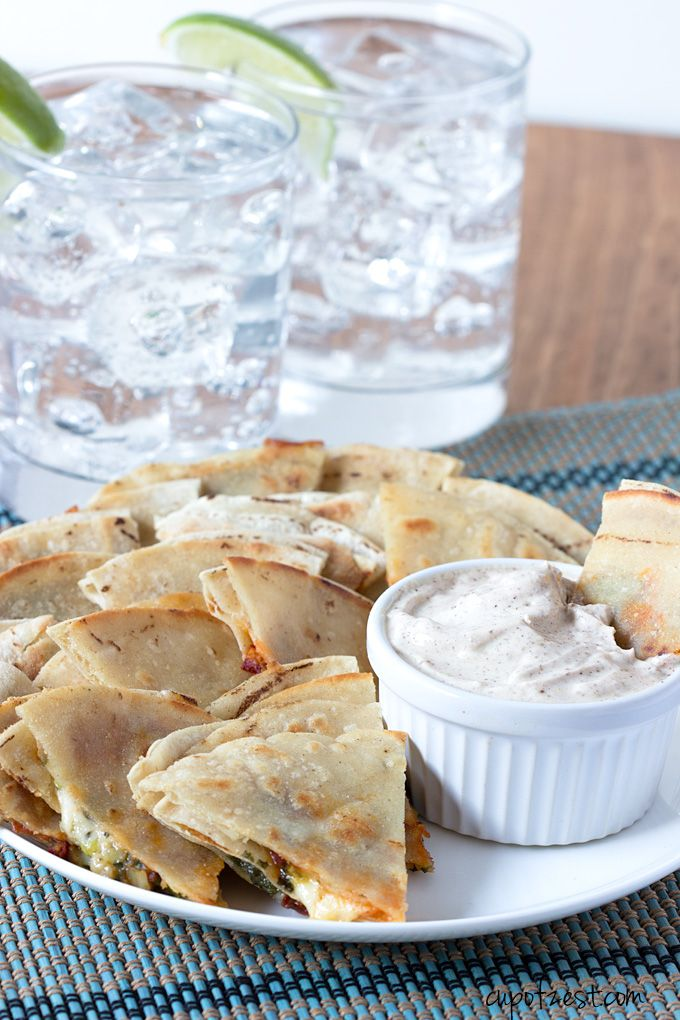 Spicy Chipotle Quesadillas - A simple recipe for quesadillas filled with cilantro, scallions, chipotle peppers, and jack cheese with a Greek yogurt dip. Perfect as an appetizer or snack! - cupofzest.com