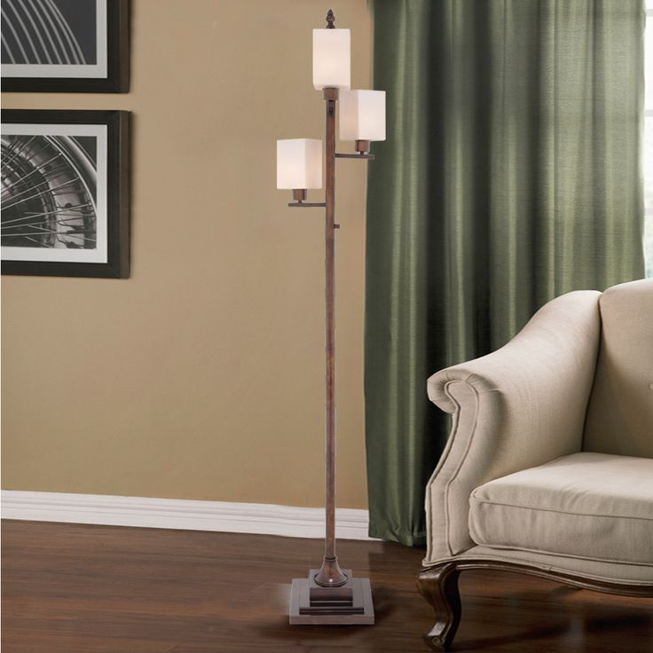 Illuminate a dark corner with this Catalina colored glass and metal 4-light transitional floor lamp.