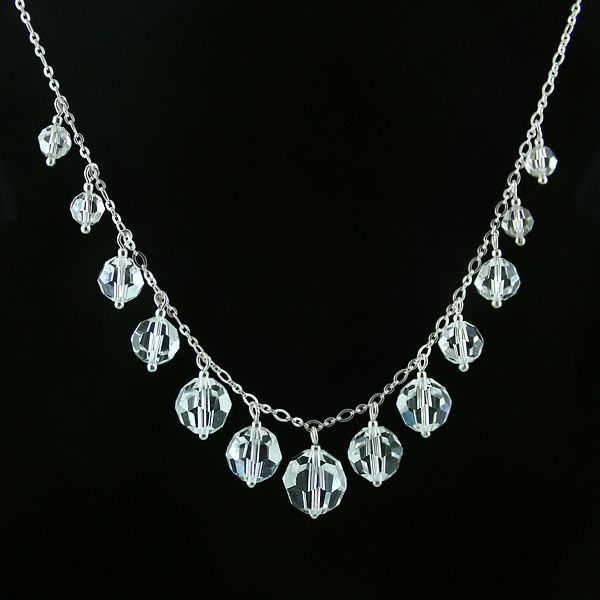 Beautiful necklace made of transparent Swarovski Round crystals and silver. Silver chain. Classic and elegant.