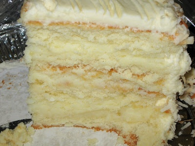 Mile-High Coconut Cake - A tall coconut cake with coconut cream filling and a coconut cream cheese frosting.  Yum!