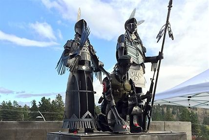 "A new sculpture by renowned First Nation artist Smoker Marchand was unveiled in Westbank.  Marchand says the steel monument, which depicts three warriors in full battle dress, represents veterans of all backgrounds who have served in the military.  ""I wanted to show a strong Indian man. I wanted to show a strong Indian woman. And I wanted to show a soldier who could be any soldier,"" he says."