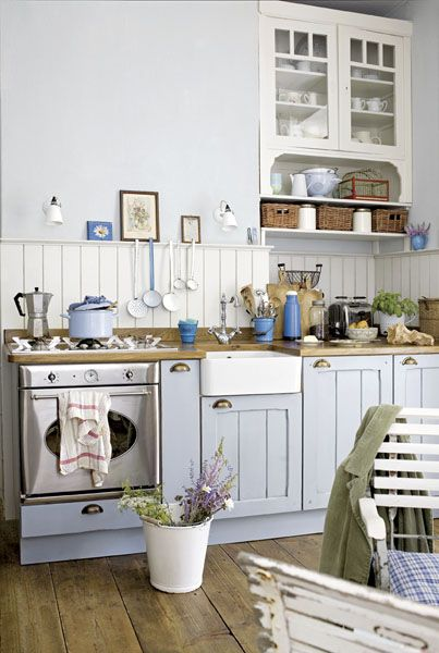 touch of blue and great cabinet pulls. I used a slightly darker version of gray like this...a warm gray and I love it!