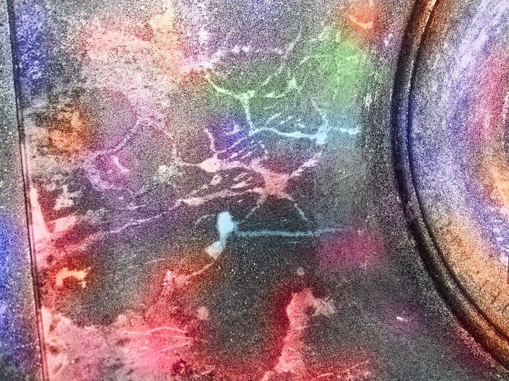 Sand blaster dust accumulating on a plastic bucket. colored in  Darktable