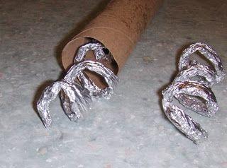 Super simple #DIY rain stick from aluminum foil and a paper towel tube