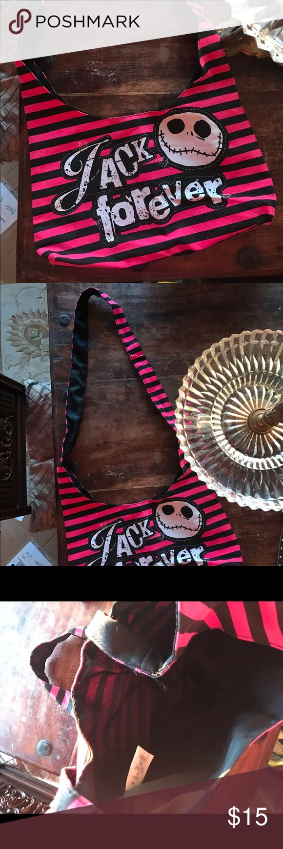 Nightmare Before Christmas Purse Disney's Pink and black striped Nightmare Before Christmas Jack Skellington Purse.  Measurements: Strap Drop- 21 inches Depth- 9 inches  Length- 15 inches Disney Bags Crossbody Bags