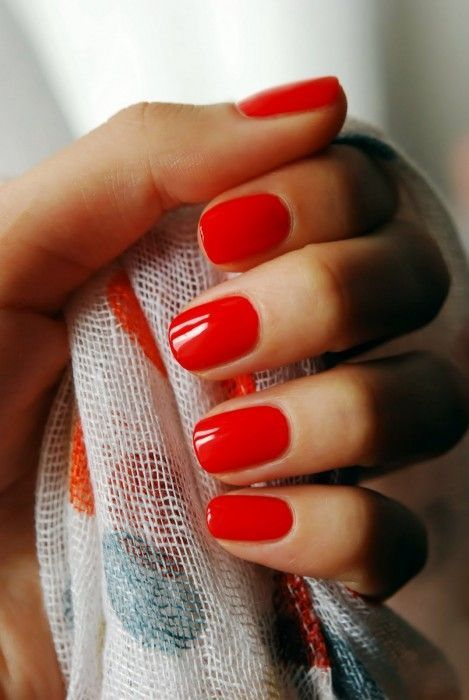 Glamorous hot red nail fashion paired with the scarf for a perfect Fourth of July accessory.