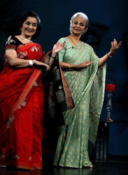 Indian Bollywood actress Waheeda Rehman (R) and Asha Parekh perform onstage during the talk show in Mumbai.