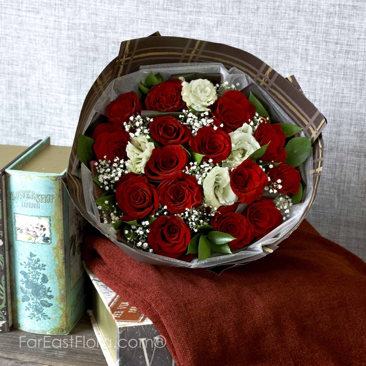 PT20 - More Than Words  Tongue-tied by her breathless charm? This bold bouquet of passionate red roses interlaced with chaste white eustomas does the job of saying how much she has made a difference in your life. It lays claim to the vast territory of your heart, which she has conquered.