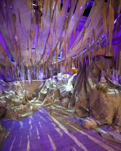 Simple paper, fabric, and packing tape were used to transform the crafts room into a sparkling crystal cave.