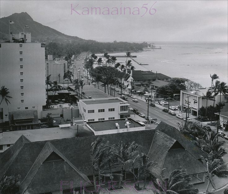 """Old news photo date-stamped 1956 looking Diamond Head along Kalakaua Avenue taken from an upper floor at the 1955 Princess Kaiulani Hotel. A wonderful vignette of life at the end of the territorial era.  Photo notes -  1899 Castle Mansion """"Kainalu"""" (by then Waikiki Elks Club) on the ocean at the tip of Diamond Head - 1927 Waikiki Natatorium in front of the Waikiki Elks Club - 1928 Waikiki Inn and Tavern across Kalakaua Avenue, center - 1941 Waikiki Bowl next to Waikiki Tavern - 1955..."""
