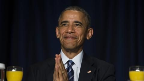 President Barack Obama bows his head towards the Dalai Lama as he was recognized during the National Prayer Breakfast in Washington, Thursday, Feb. 5, 2015.  The annual event brings together U.S. and international leaders from different parties and religions for an hour devoted to faith. (AP Photo/Evan Vucci)