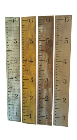 Oversized Growth Charts (DIY directions here: http://etchellfamily.wordpress.com/2012/02/20/ruler-growth-chart-make-it-monday/)