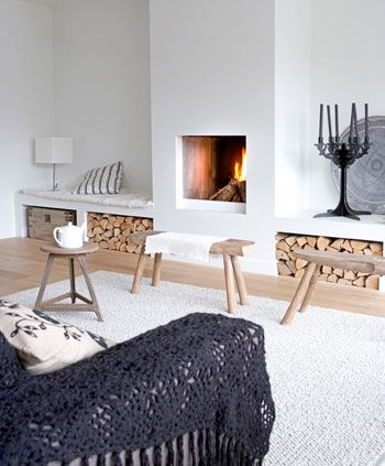 contemporary living room fireplace with log storage