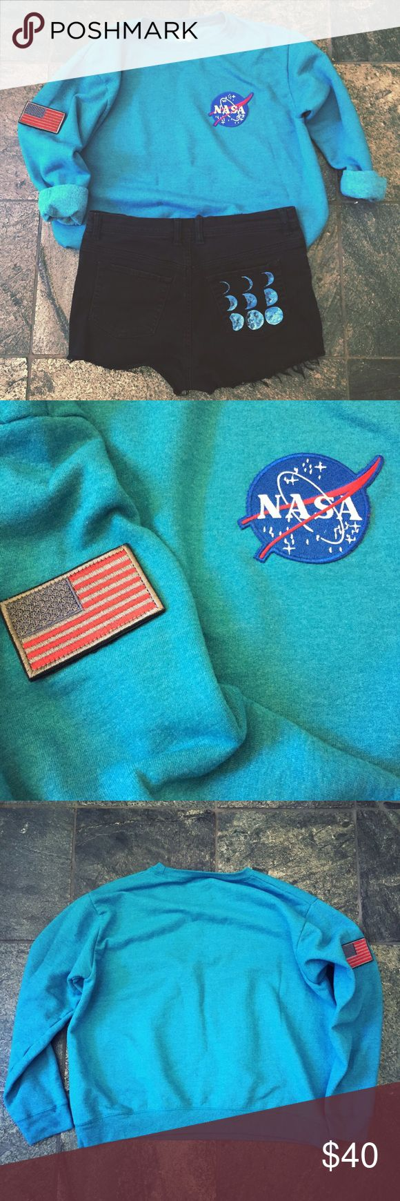 One Of A Kind NASA Jumper  Blue crewneck sweatshirt with hand sewn NASA and American flag patches. Hanes soft sweats with Eco smart yarn has never been so science-geek or patriotic  (Or... not patriotic? Seeing as how we're talking outer space here). The pullover is a size large, but I'm listing it as medium because, in addition to fitting size L, it is wonderfully cozy and fashionably oversized on sizes small and medium.... Moon shorts listed separately! Hanes Sweaters Crew & Scoop Necks