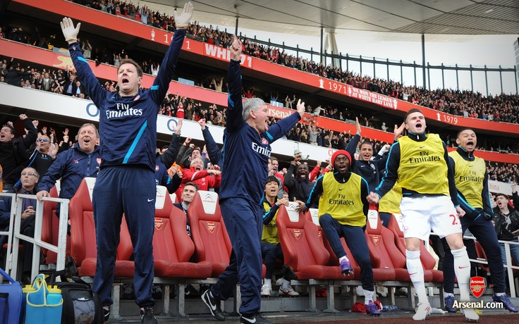 The Arsenal bench celebrate against Tottenham Hotspur. North London is Red!