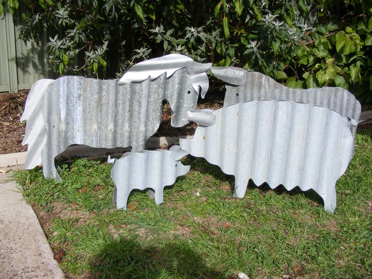 Pony, donkey and pigs created from recycled corrugated iron